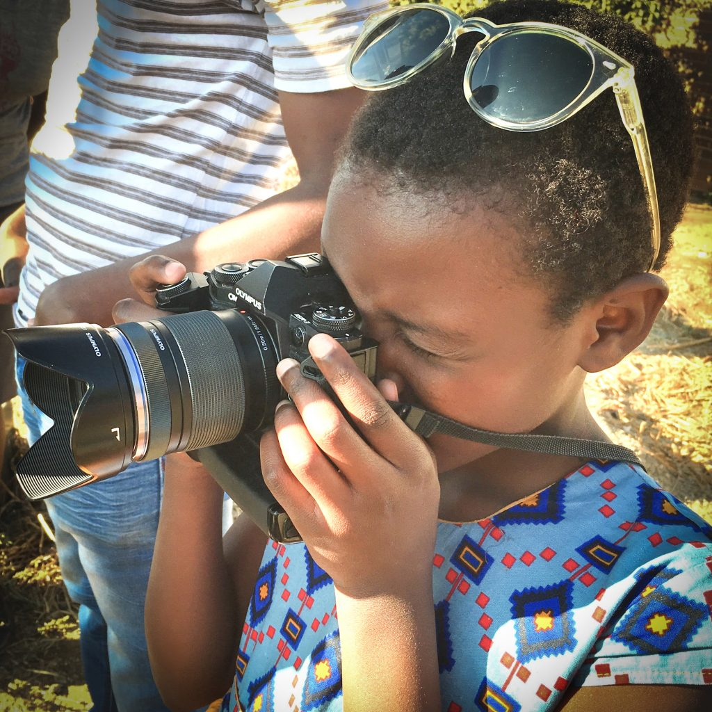young female photographer interested in technology